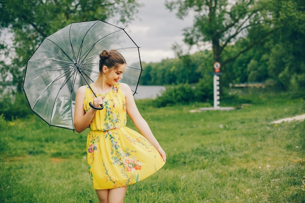 Yound and pretty girl in a summer park Free Photo
