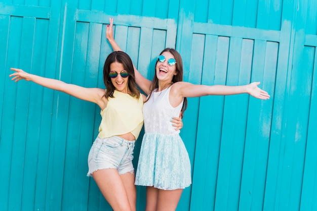 Young active hipsters women having fun together Free Photo