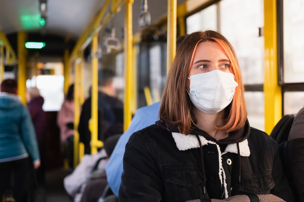 Young adult commutes in a protective face mask. coronavirus, covid-19 spread prevention concept, responsible social behaviour of a citizen Premium Photo
