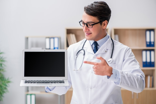 Young adult doctor with laptop computer Premium Photo