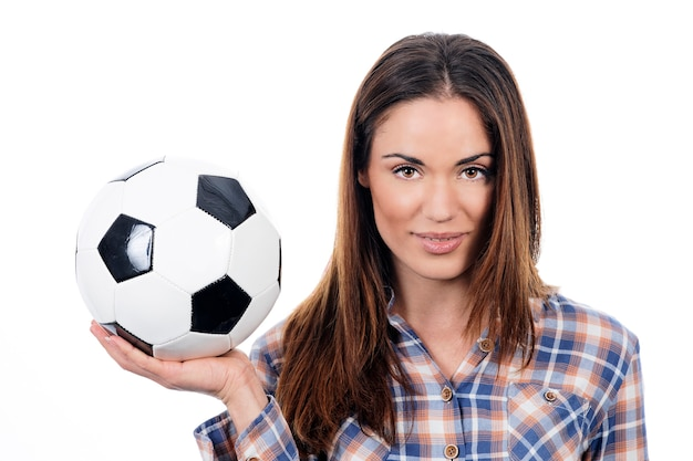 Young adult woman with ball over white background Free Photo