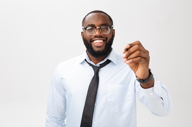 Young african american business man writing something on glass board with a marker Premium Photo