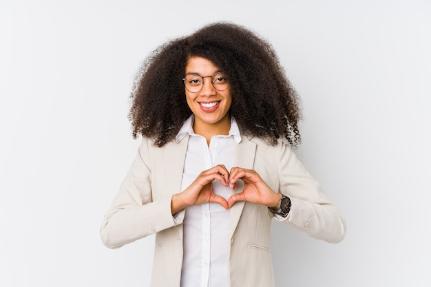 Young african american business woman smiling and showing a heart shape with hands. Premium Photo
