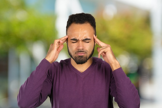 Young african-american businessman suffering from headache after hard working day Premium Photo