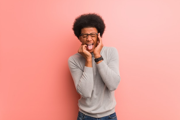 Young african american man over a pink wall desperate and sad Premium Photo