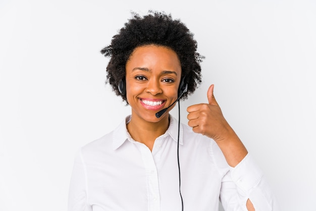 Young african american telemarketer woman isolated smiling and raising thumb up Premium Photo