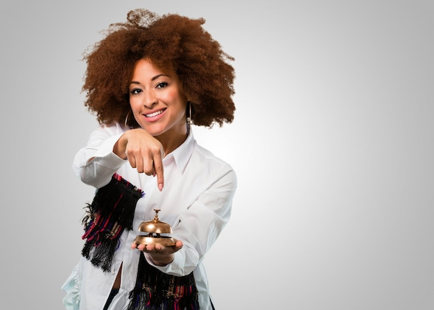 Young afro woman holding a ring bell Premium Photo