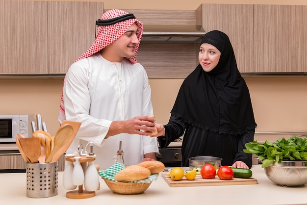 Young arab family in the kitchen Premium Photo