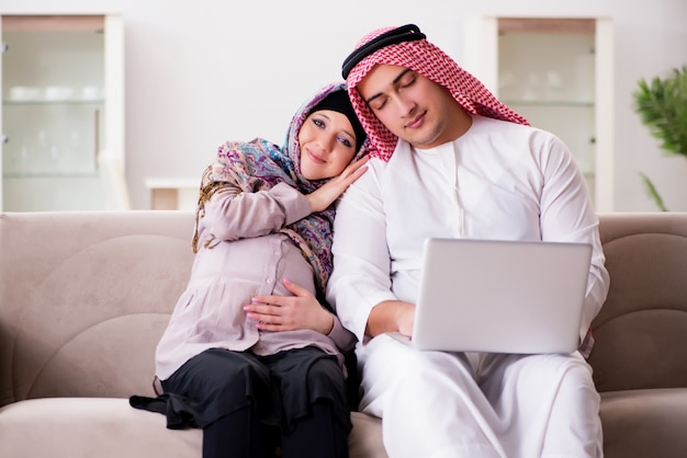 Young arab muslim family with pregnant wife expecting baby Premium Photo