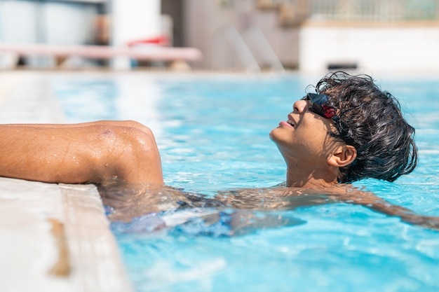 Premium Photo | Young asian boy playing at the swimming pool