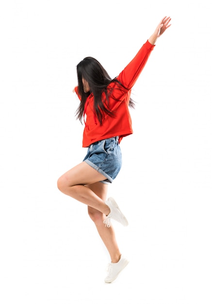 Young asian dancer over isolated white wall Premium Photo