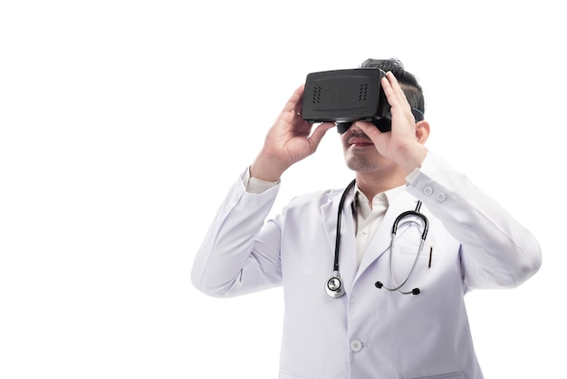Young asian doctor man with white lab coat and stethoscope using virtual reality Premium Photo