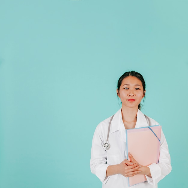 Young asian doctor with stethoscope and folder Free Photo