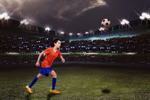 Young asian female footballer want to kicking the ball Premium Photo