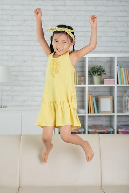 Girl having fun dancing to Christmas music at home