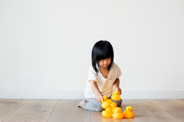 Young Asian girl playing alone Free Photo