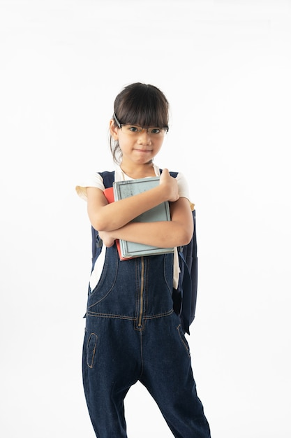 Young asian girl student holding book over head isolated on white background,  education and learning Premium Photo