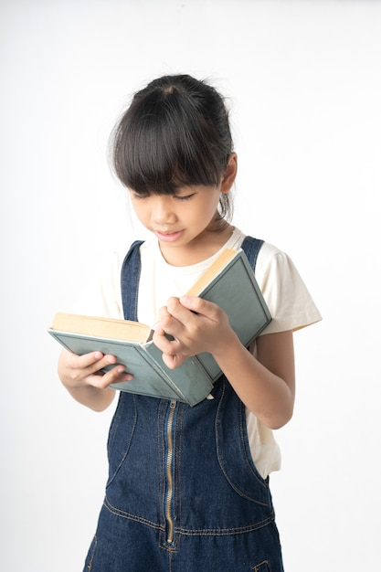 Young Asian Girl Student Reading Book Isolated On White
