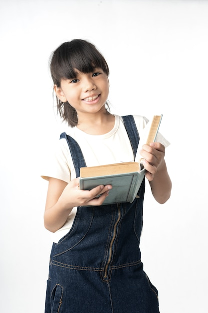 Young asian girl student reading book isolated on white background Premium Photo