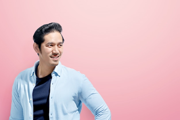 Young asian man in casual clothes standing Premium Photo