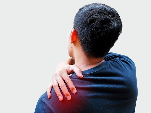 Young asian man suffering from back pain, shoulder pain and office syndrome. Premium Photo