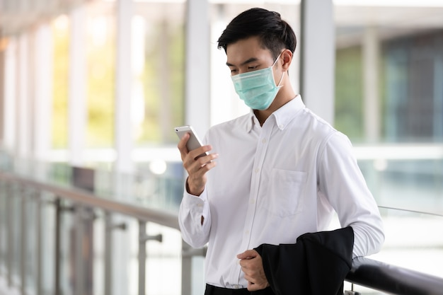 Young asian man wear medical face mask for protection coronavirus ...