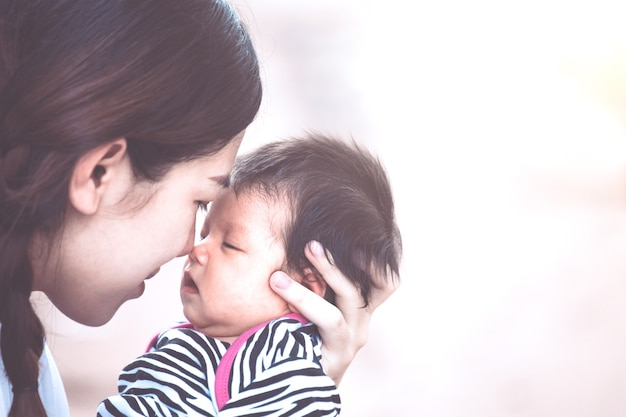 Young Asian Mother Hugging And Kissing Her Newborn Baby Girl With Interesting Child Love Images Download