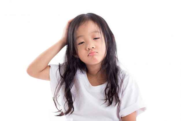 Young asian sleepy girl isolated over white background Premium Photo