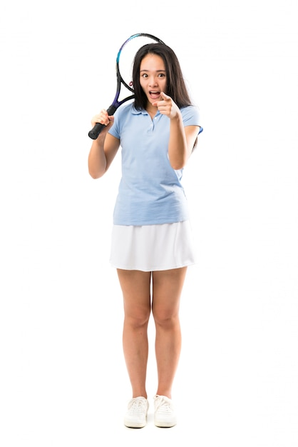 Young asian tennis player surprised and pointing front Premium Photo