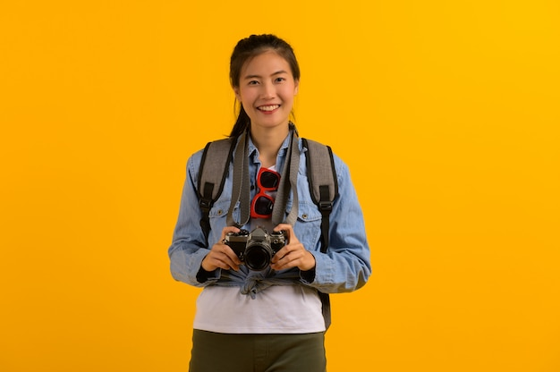 Young asian tourist woman preparing for travel Premium Photo