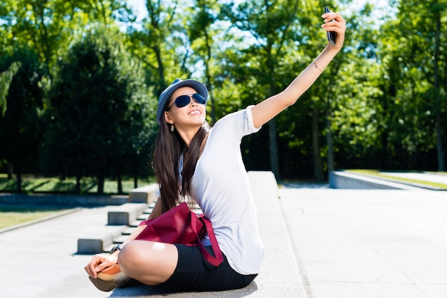 Young asian woman making selfie pictures Premium Photo