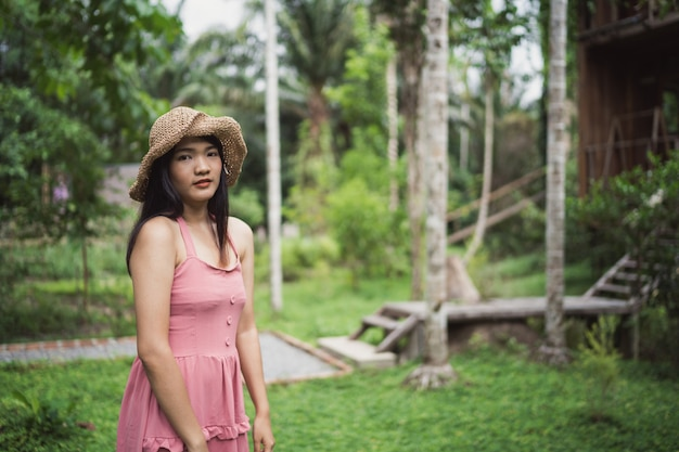 Young asian woman relax in forest, beautiful female happy using relax time in nature. Free Photo