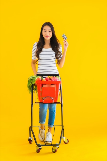Young asian woman shopping grocery cart from supermarket Free Photo