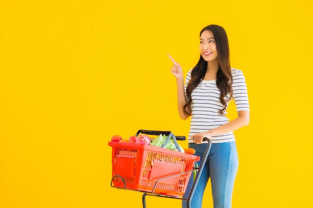 Young asian woman shopping grocery from supermarket and cart Free Photo