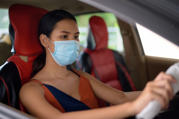 Young asian woman wearing mask for protection from corona virus ...