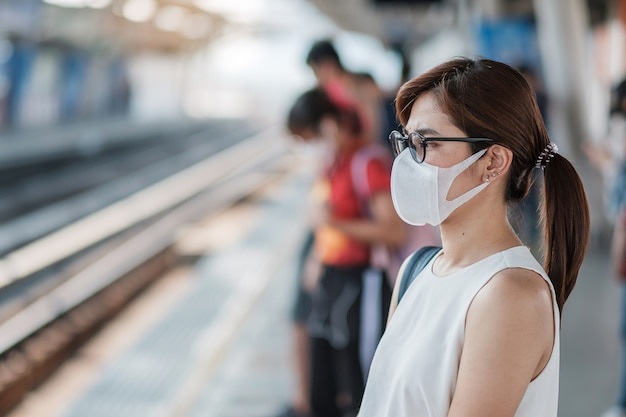 Young asian woman wearing protection mask against novel ...