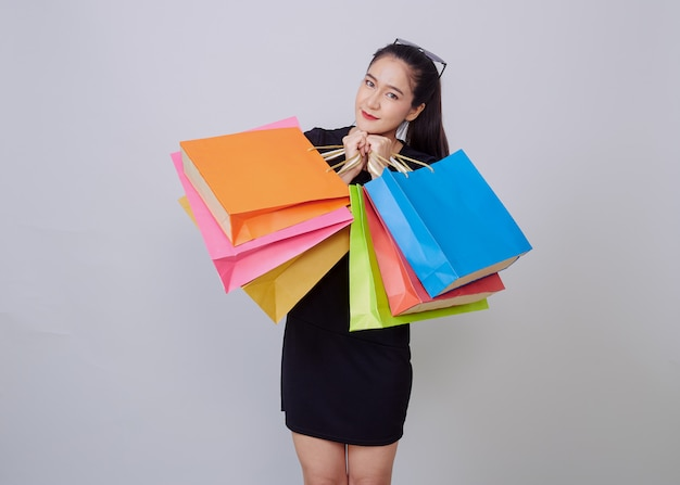 Young asian woman with colorful shopping bags Premium Photo