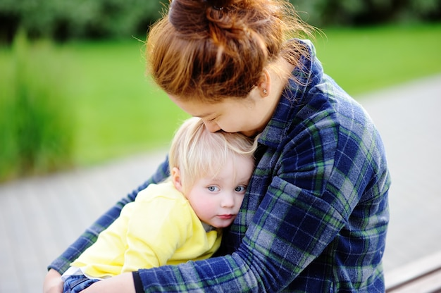 Young asian woman with cute caucasian toddler boy. Premium Photo