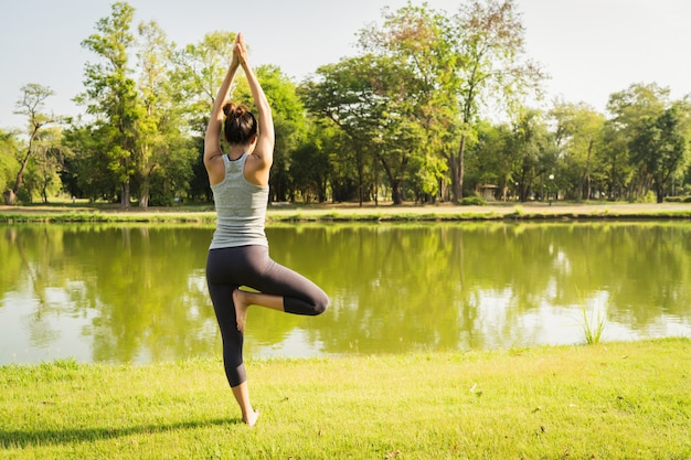 Young asian woman yoga outdoors keep calm and meditates while practicing yoga Free Photo