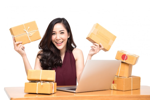 Young asian women with startup small business entrepreneur freelance working at home and excited about the orders of many customers, online marketing packing box delivery concept Premium Photo