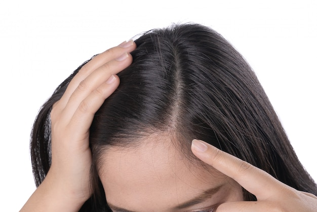 Young asian women worry about problem hair loss, head bald, dandruff. Premium Photo