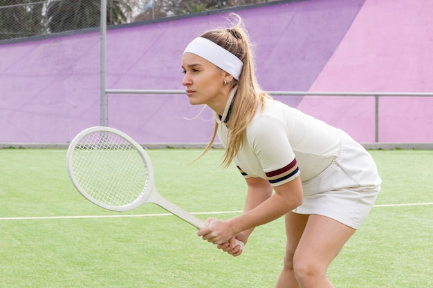 Young athlete playing tennis intense Free Photo