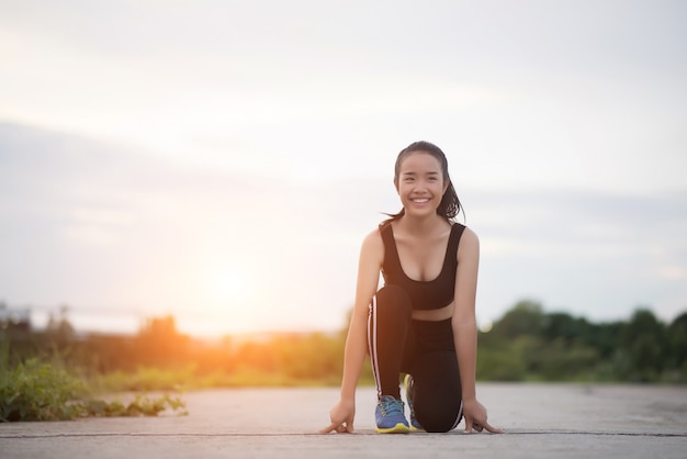 Young athlete woman is ready to start run or jogging Free Photo