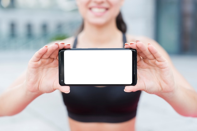 Young athlete woman with a smartphone Free Photo