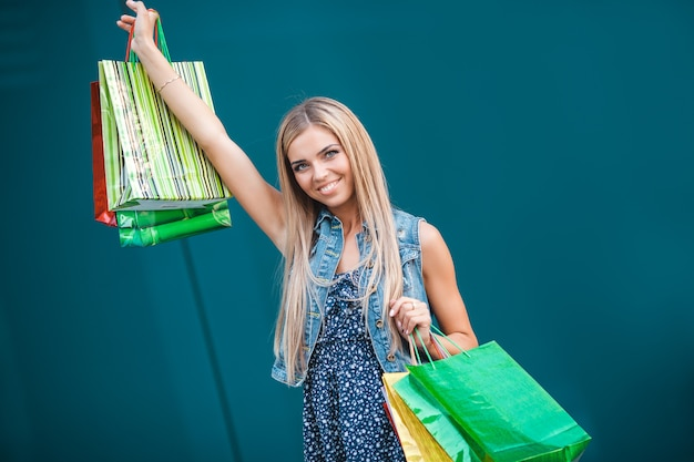 Young atractive woman with shopping bags outdoors Premium Photo