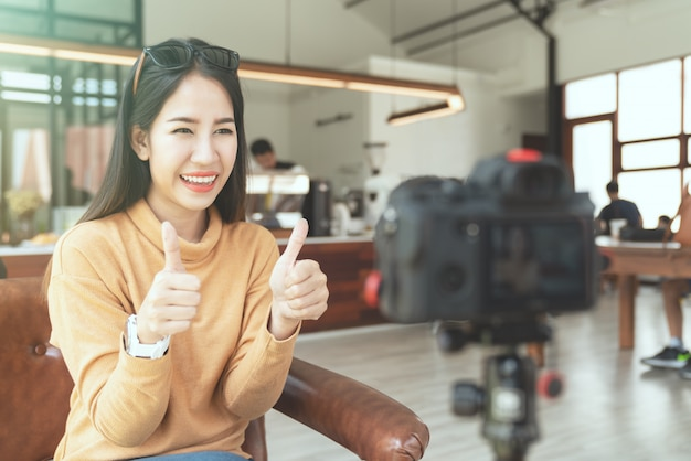 Young attractive asian woman blogger or vlogger Premium Photo
