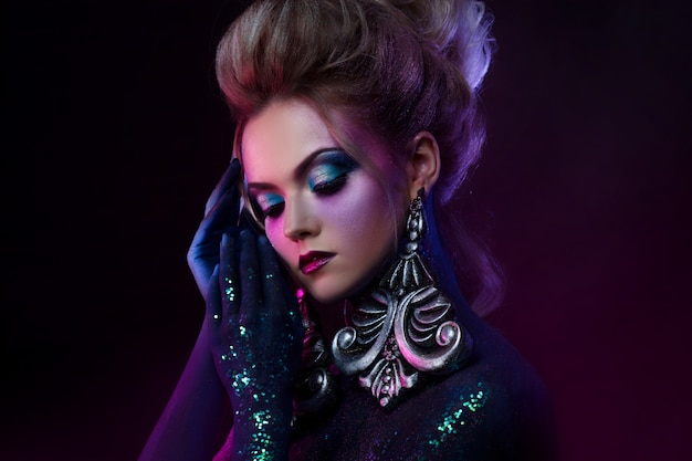 Premium Photo Young Attractive Blonde Girl In Bright Art Makeup In Purple Tones Rhinestones And Glitter Body Painting