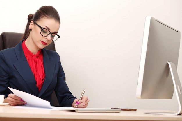 Young and attractive business woman working in office Premium Photo
