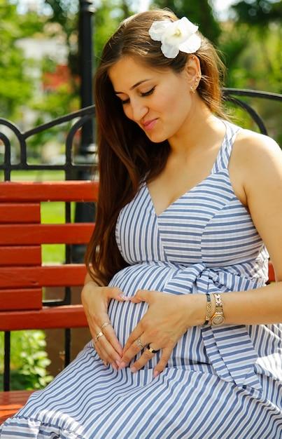 Young attractive pregnant woman. city lifestyle concept. Premium Photo