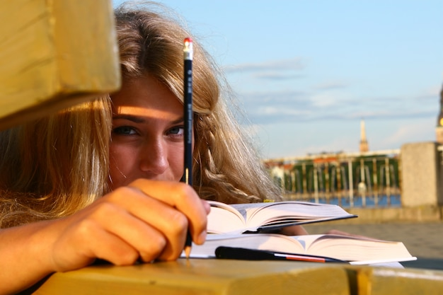 Young attractive student reading the book Free Photo